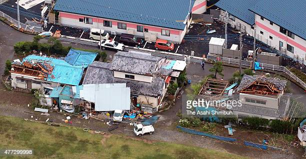 In this aerial image, roofs of houses are blown off by a strong winds on June 15, 2015 in Isesaki, Gunma, Japan. The blustery winds overturned cars...