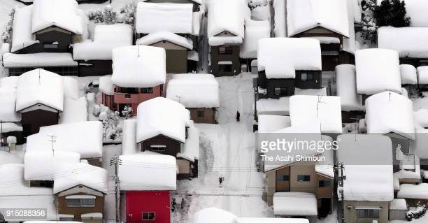 In this aerial image roofs of houses are covered with snow on February 6 2018 in Echizen Fukui Japan The SelfDefense Forces were called out to rescue...