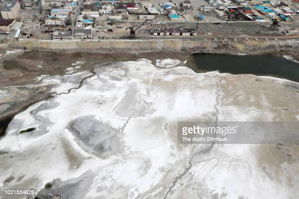 In this aerial image salt covered area spreads next to an residential district on April 20 2018 in Aral Kazakhstan The Aral Sea used to be the fourth...