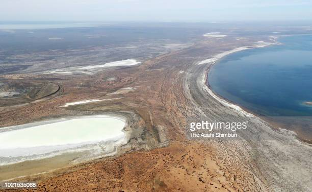 In this aerial image saltcovered exposed seabed and shrinking Aral Sea are seen on April 21 2018 in Kazakhstan The Aral Sea used to be the fourth...