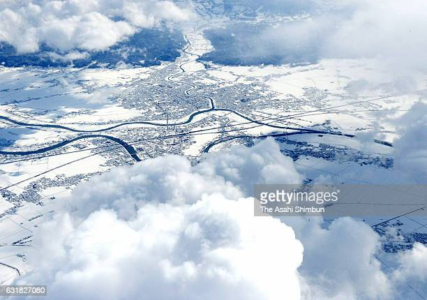 In this aerial image Sanjo city is covered with snow as snow falls in wider area on January 15 2017 in Sanjo Niigata Japan The Meteorological Agency...