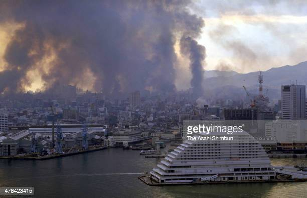 In this aerial image smoke arise from various locations after the strong earthquake on Janaury 17 1995 in Kobe Hyogo Japan Magnitude 73 strong...