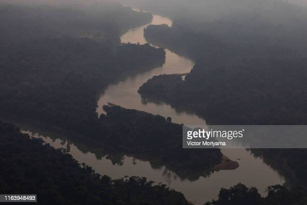 In this aerial image smoke covers a section of the Amazon rain forest affected by wildfires on August 25 2019 in the Candeias do Jamari region near...