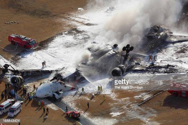 In this aerial image, smoke from FedEx airplane 80 is seen while fire fighters try to extinguish at Narita International Airport on March 23, 2009 in...