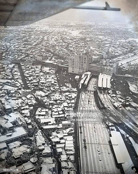 In this aerial image snow capped Shibuya area and Shibuya Station are seen on January 24 1956 in Tokyo Japan A large scale redevelopment around...