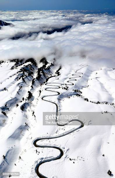 In this aerial image snow clearing is under way at the Tateyama Kurobe Alpine Route to prepare for the opening of the road in April on March 17 2018...