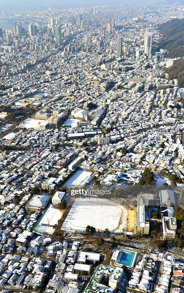 In this aerial image, snow covered Kobe city is seen on January 28, 2013 in Kobe, Hyogo, Japan. Snow poured in western Japan and Boso Peninsula due to strong low pressure.