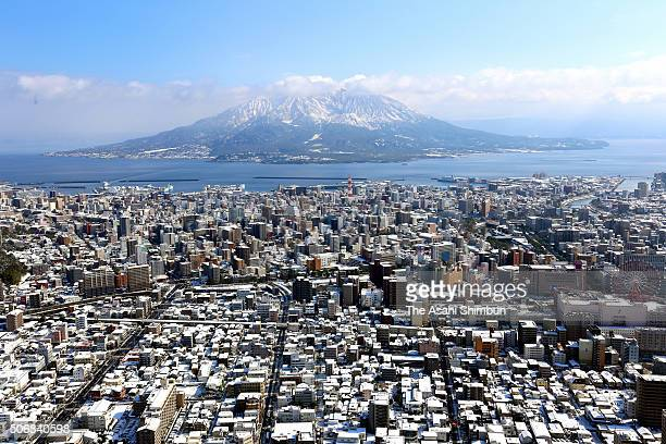 In this aerial image snowcovered Kagoshima city and Mount Sakurajima are seen on January 25 2016 in Kagoshima Japan Low temperatures also set a...