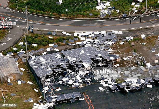 In this aerial image, some 200 solar panels are blown off by strong winds on June 15, 2015 in Isesaki, Gunma, Japan. The blustery winds overturned...
