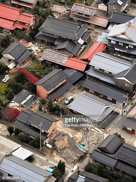In this aerial image some buildings are damaged after the magnitude 66 earthquake hit the area on October 21 2016 in Kurayoshi Tottori Japan A quake...