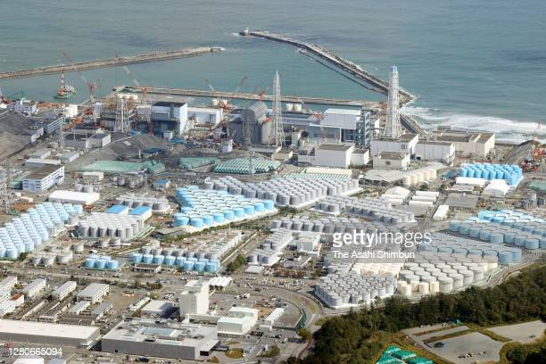 In this aerial image, storage tanks holding contaminated water line the grounds of the Fukushima Daiichi Nuclear Power Plant on October 16, 2020 in...