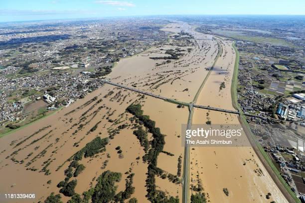 In this aerial image, swollen Arakawa River is seen after Typhoon Hagibis on October 13, 2019 in Okegawa, Saitama, Japan. Ten people died and 12 were...