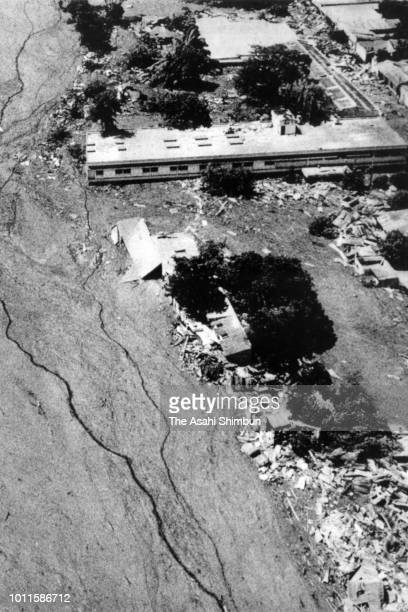 In this aerial image, the city of Armero is buried by lahars triggered by the eruption of the Mt. Nevado del Ruiz destroyed the city on November 24,...
