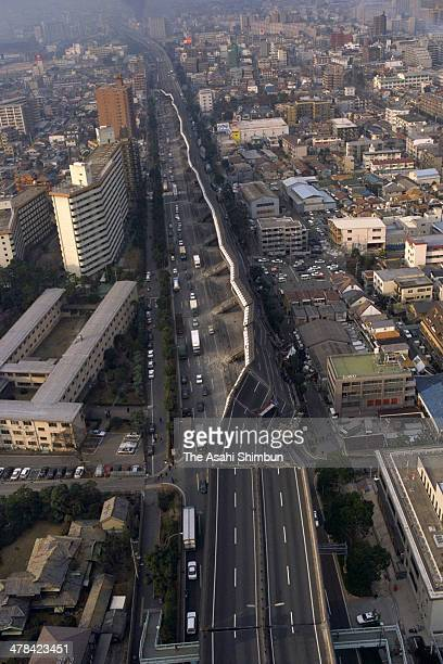 In this aerial image the collapsed Hanshin Expressway elevated highway is seen on Janaury 17 1995 in Kobe Hyogo Japan Magnitude 73 strong earthquake...
