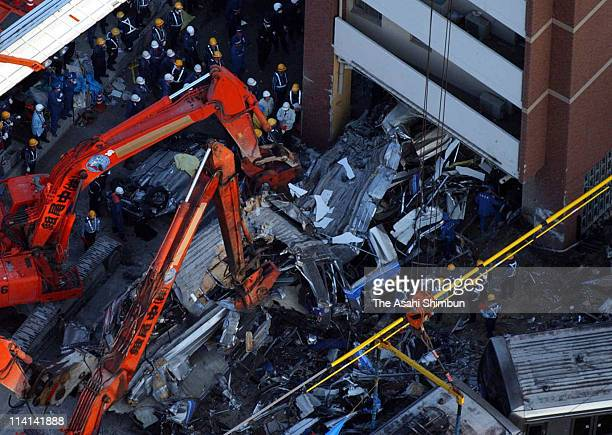 In this aerial image the crushed commuter train is salvaged from an apartment building on April 25 2005 in Amagasaki Hyogo Japan 107 people have so...