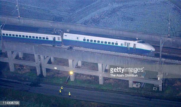 In this aerial image the derailed Joetsu Shinkansen Toki 325 is seen on October 23 2004 in Nagaoka Niigata Japan The quake later called Niigata...