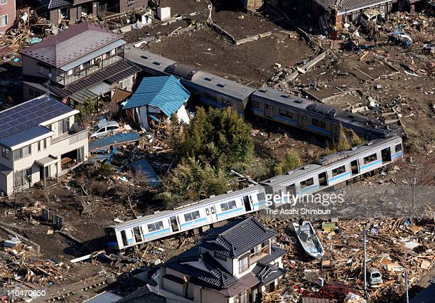 In this aerial image the derailed JR East Senseki Line train are seen on March 19 2011 in Higashimatsushima Miyagi Japan Thousands have been killed...