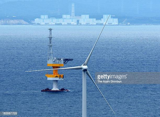 In this aerial image the Fukushima Mirai wind turbine floats 20 kilometers off the coast of Fukushima Prefecture the crippled Fukushima Daiichi...
