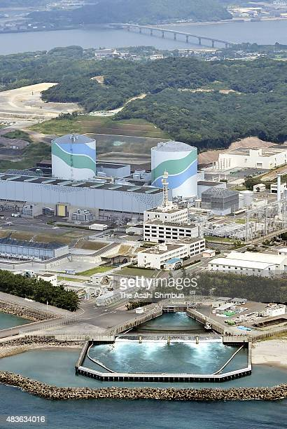 In this aerial image the Kyushu Electric Power Co 's Sendai nuclear power plant No 1 reactor which is activated today is seen on August 11 2015 in...