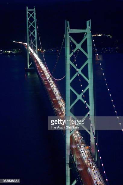 In this aerial image the lanes bound for Kobe Osaka and the surrounding area are clogged with cars returning from vacations during the Golden Week...