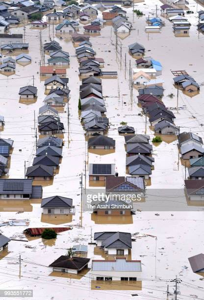 In this aerial image the Mabicho area is submerged after Odagawa River banks collapse due to heavy rain on July 7 2018 in Kurashiki Okayama Japan 51...