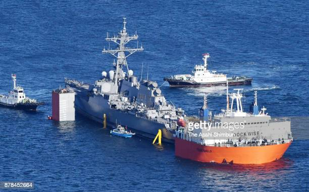 In this aerial image the process to load damaged USS Fitzgerald on to Heavy Load Carrier Transshelf continues off Yokosuka on November 24 2017 in...