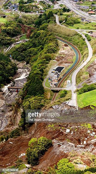 In this aerial image, the rail of Minamiaso Railways are destroyed by a landslide on April 26, 2016 in Minamiaso, Kumamoto, Japan. 49 people have...
