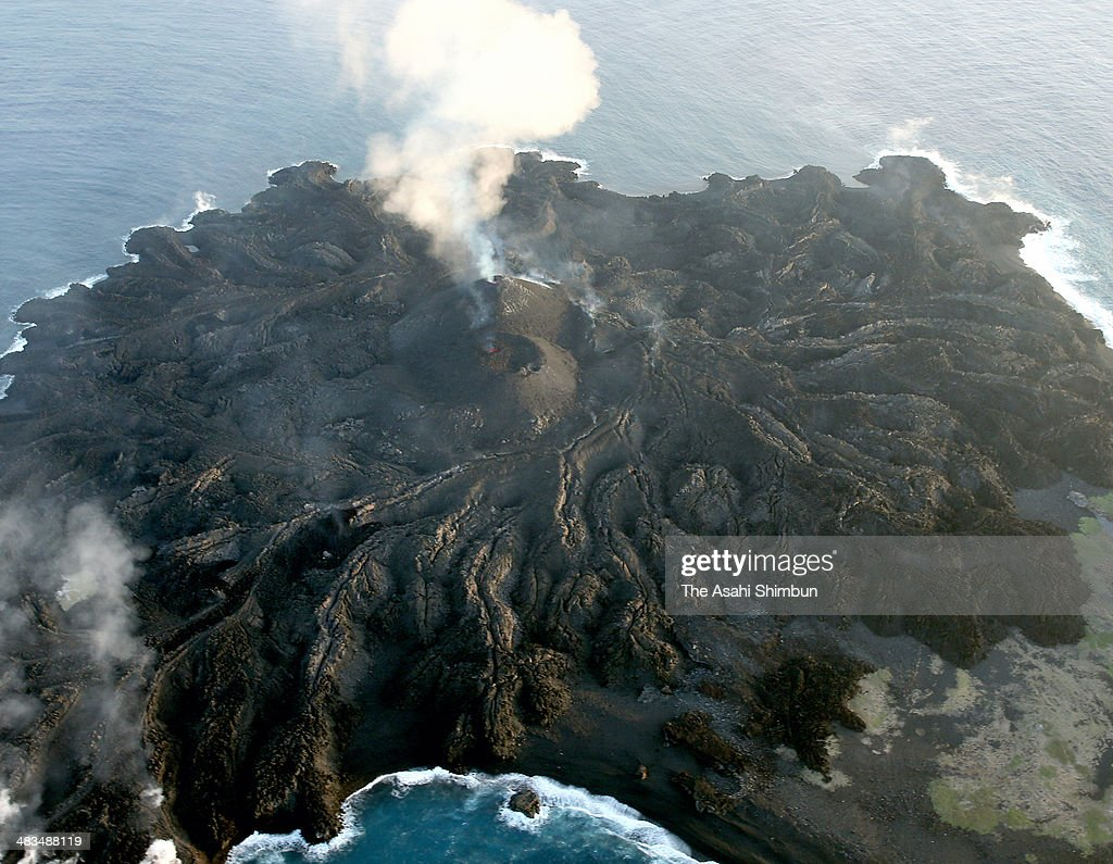 In this aerial image, the recently formed islet, which is connected to neighboring Nishinoshima island, continues its volcanic activity on April 7, 2014 in Ogasawara, Tokyo, Japan. The islet was first spotted November 20, 2013 by the Japan Coast Guard. Lava flows from the continued volcanic activity on the island became connected to nearby Nishinoshima island in late December. When observed by the coast guard on March 24, the islet had an area of 0.7 square kilometer, 3.5 times the original size of the Nishinoshima island.