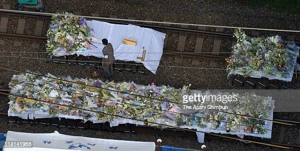 In this aerial image the stand is full of offered flower bunches at the train derailment site on April 30 2005 in Amagasaki Hyogo Japan 107 people...