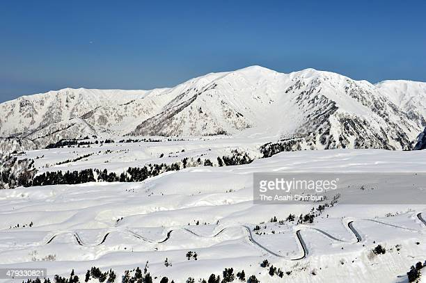 In this aerial image the Tateyama Kurobe Alpine Route is seen as snow removal work continues on March 17 2014 in Tateyama Toyama Japan The route...