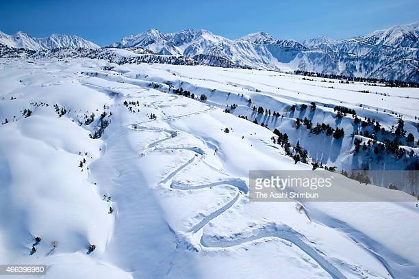 In this aerial image the Tateyama Kurobe Alpine Route snow removal work continues on March 15 2015 in Tateyama Toyama Japan The route connecting...