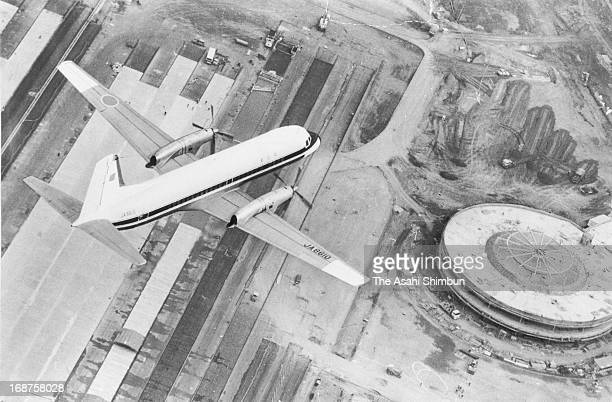 In this aerial image the transport ministry's YS11 aircraft operates the beacon sign testing flight above the New Tokyo International Airport on...