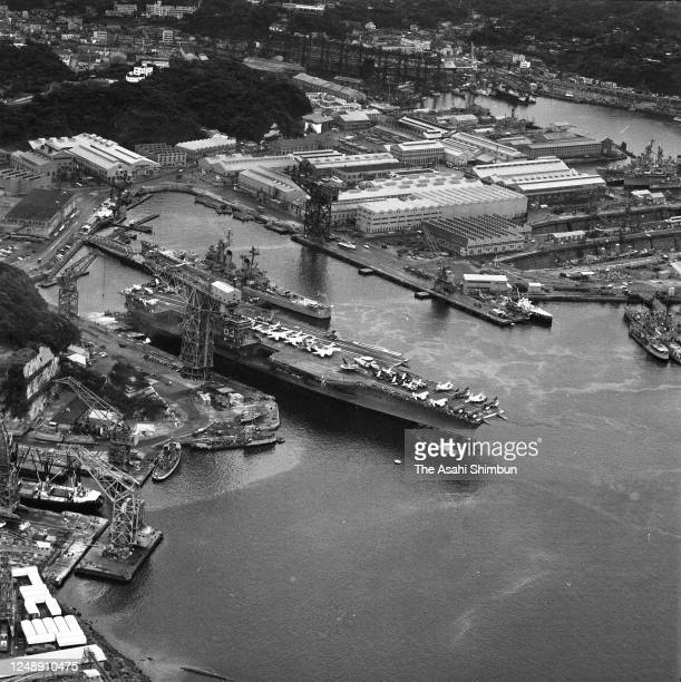 In this aerial image, the U.S. Aircraft carrier USS Kitty Hawk arrives at the Fleet Activities Yokosuka on May 29, 1966 in Yokosuka, Kanagawa, Japan.