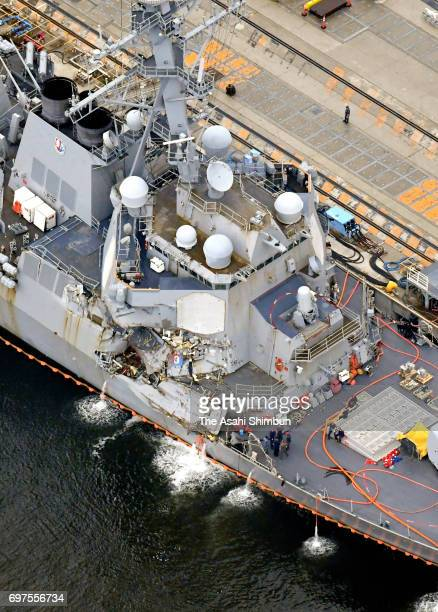 In this aerial image the USS Fitzgerald which suffered severe damage on the starboard side is anchored at the US naval base on June 18 2017 in...