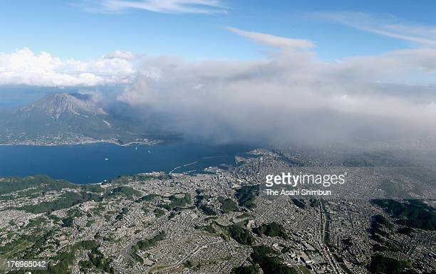 In this aerial image the volcanic smoke spews from Mount Sakurajima to cover the city center with ash on August 19 2013 in Kagoshima Japan The Japan...