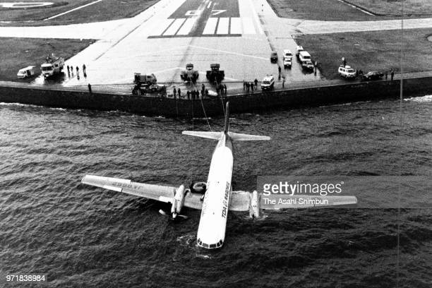 In this aerial image, Toa Domestic Airline 670 is seen in the sea after overrunning the runway at Yonago Airport on January 10, 1988 in Sakaiminato,...