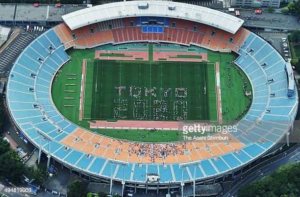 In this aerial image 'Tokyo 2020' is formed by human letters prior to the Aisan Five Nations match between Japan and Hong Kong at the National...