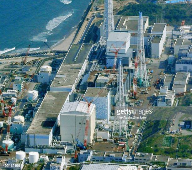 In this aerial image Tokyo Electric Power Co Fukushima Daiichi Nuclear Power Plant is seen on June 2 2014 in Okuma Fukushima JapanThe construction of...