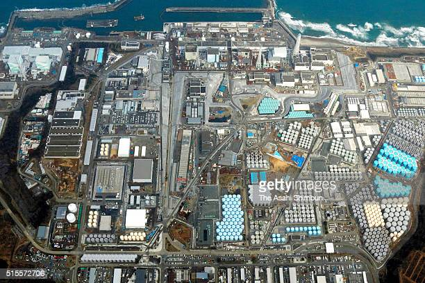 In this aerial image Tokyo Electric Power Co's Fukushima Daiichi Nuclear Power Plant on March 12 2016 in Okuma Fukushima Japan The No1 reactor of the...