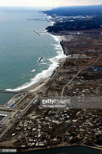 In this aerial image Tokyo Electric Power Co's Fukushima Daiichi Nuclear Power Plant and Ukedo area are seen on March 12 2016 in Namie Fukushima...