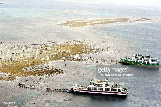 In this aerial image tourists land onto coral reef of Yabiji on March 29 2009 in Miyako Okinawa Japan the coral reef appears on the sea level when...