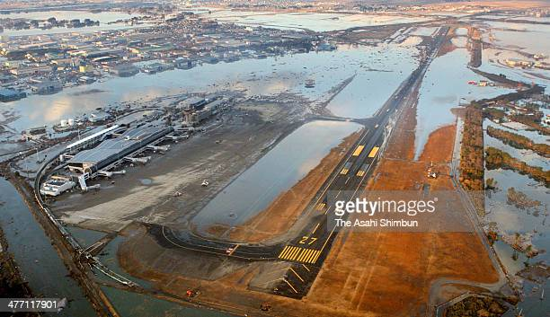 In this aerial image tsunami flood covered Sendai Airport is seen a day after the Magnitude 90 strong earthquake and subsequent tsunami on March 12...