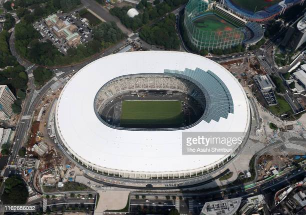 In this aerial image turfing begins at new National Stadium on July 17 2019 in Tokyo Japan With most of the construction work complete grass started...