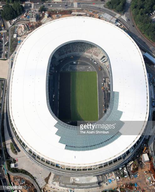 In this aerial image, turfing begins at new National Stadium on July 17, 2019 in Tokyo, Japan. With most of the construction work complete, grass...