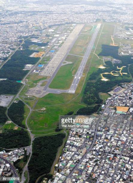 In this aerial image US Marine Corps Air Station Futenma and Futenma Daini Elementary School are seen on December 13 2017 in Ginowan Okinawa Japan A...