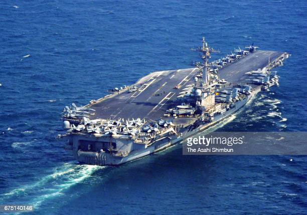 In this aerial image US Navy's nuclearpowered aircraft carrier Carl Vinson travels about 30 kilometers south of Tsushima island in a...