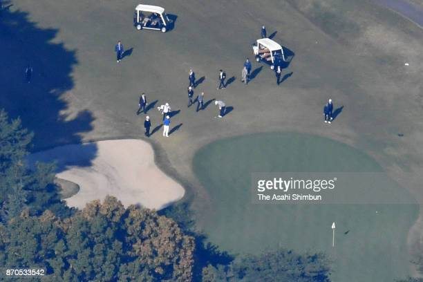 In this aerial image US President Donald Trump plays golf with Japanese Prime Minister Shinzo Abe and Hideki Matsuyama at Kasumigaseki Country Club...