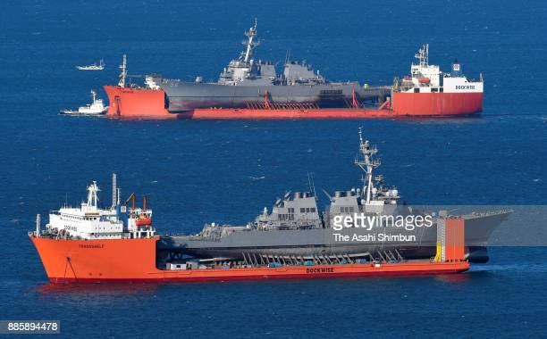 In this aerial image USS John S McCain loaded on Heavy Load Carrier arrives while USS Fitzgerald is seen on December 5 2017 in Yokosuka Kanagawa...