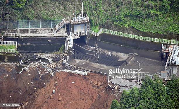 In this aerial image water storage tank of the Kurokawa Daiichi Power Plant is washed away by a landslide on May 7 2016 in Minamiaso Kumamoto Japan