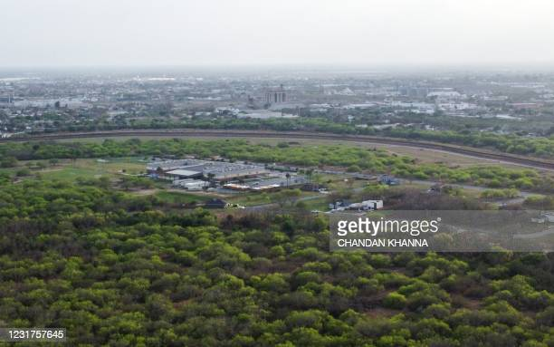 In this aerial photo, a border fence divides the cities of Brownsville, Texas, and Matamoros, Mexico, on March 15, 2021 in Brownsville, Texas. - It's...